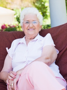 Senior woman sitting on garden chair